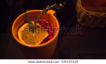 delicious hot tea with lemon and cranberries