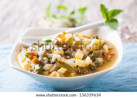 Delicious hot vegetarian meal with fresh herbs