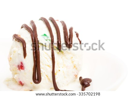 Delicious ice cream dessert with candied fruits and covered with dark chocolate. Macro. Photo can be used as a whole background. - stock photo