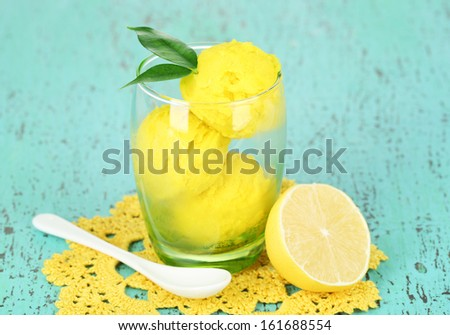 Delicious ice cream in glass on wooden table close-up - stock photo