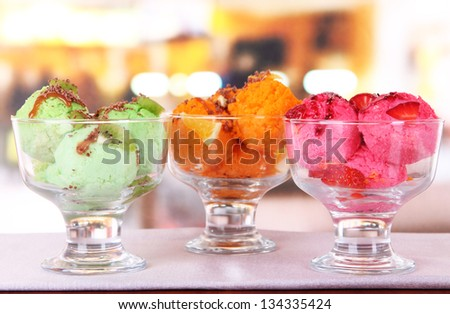 Delicious ice cream on table in cafe - stock photo