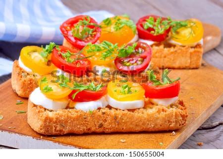 Delicious italian appetizer bruschetta over wooden background - stock photo