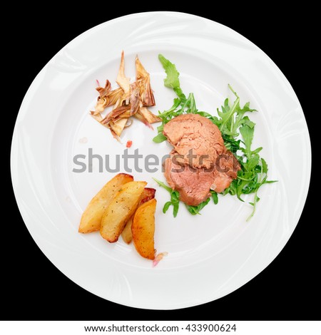 Delicious Italian Chianina beef dish isolated on black background - stock photo