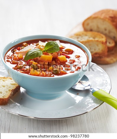 Delicious Italian minestrone soup with bread