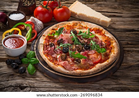 Delicious italian pizza served on wooden table, close-up. - stock photo