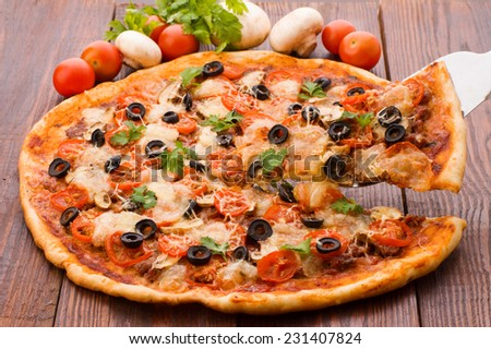 Delicious italian pizzas lifted slice 1 - stock photo
