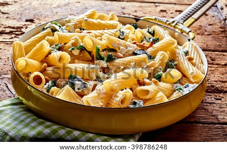 Delicious Italian ricotta pasta appetizer with fresh spinach and cheese for a healthy Mediterranean diet - stock photo