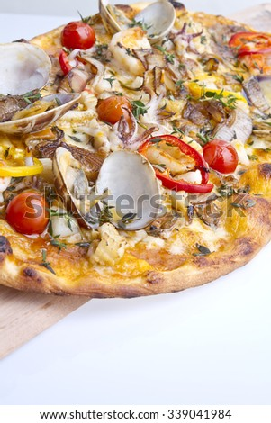 delicious italian seafood crust pizza macro - stock photo