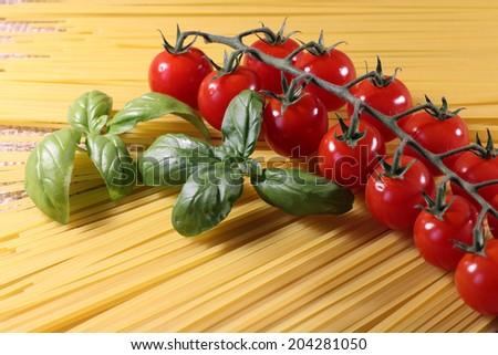 Delicious Italian spaghetti pasta with cherry tomatoes and basil.Mediterranean recipe.Close up  - stock photo