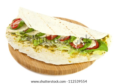 Delicious italian wrap on wooden plate isolated over white