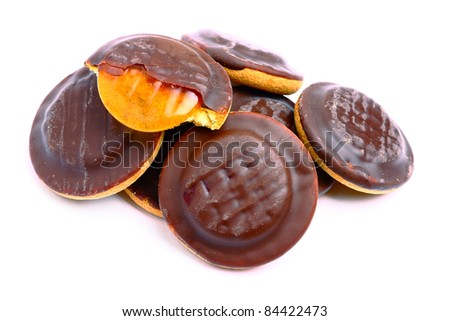 Delicious jaffa cakes with chocolate glaze - stock photo