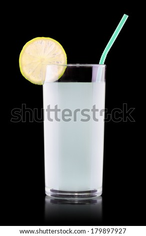 Delicious lemon juice in glass and limes isolated