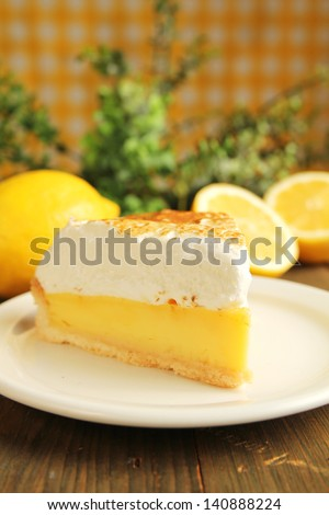 Delicious lemon pie with meringue in a white plate