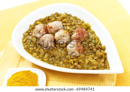 Delicious lentils with meat balls and turmeric