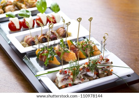 delicious looking side dishes / appetizer food or tapas - stock photo