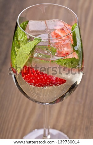 delicious looking sparkling drink with strawberries and mint - stock photo