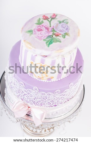 Delicious luxury white wedding or birthday cake decorated with cream colorful flowers - stock photo