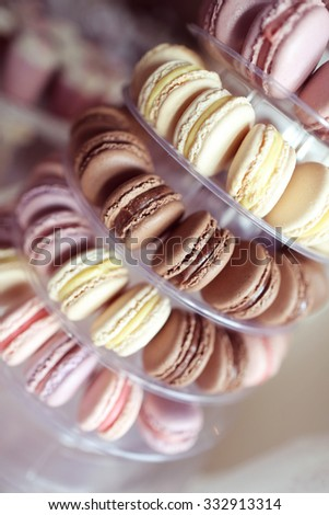 Delicious macaroons on stand - stock photo