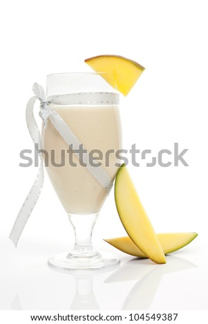 Delicious mango fruit smoothie with fresh mango fruit isolated on white background. Culinary tropical cocktail drinks.
