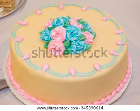 Delicious marzipan covered Baptism cake made for your Christening party. - stock photo