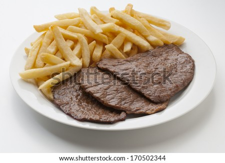 delicious meat dish with fries potatoes - stock photo
