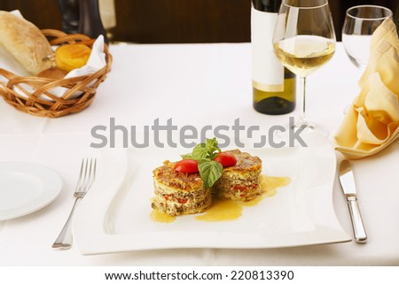 Delicious meat pie served in elegant restaurant. Traditional food. Very shallow depth of field for soft background/Restaurant meal - stock photo