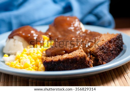 delicious meatloaf with mashed potatoes, gravy and fresh vegetables - stock photo