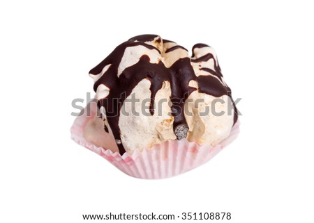 Delicious meringue cake stuffed with cream and covered with dark chocolate. Macro. Isolated on a white background. - stock photo