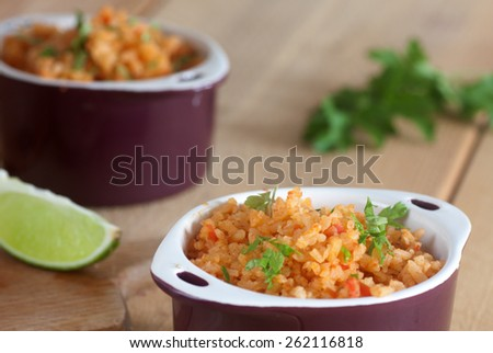 delicious mexican rice with lime - stock photo