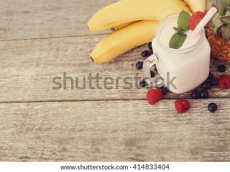 Delicious milkshake on the wooden table - stock photo