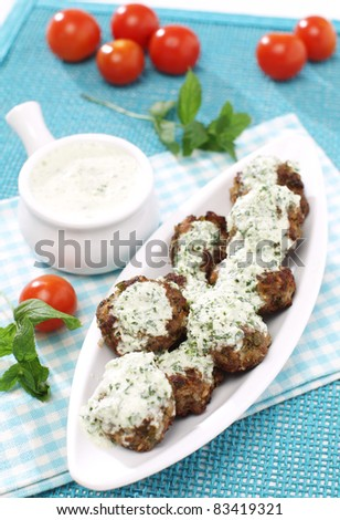 Delicious minced meat-balls with mint yogurt dressing - stock photo