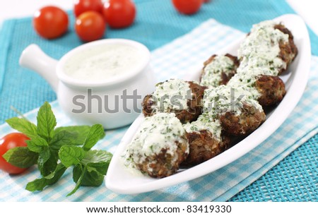 Delicious minced meat-balls with mint yogurt dressing