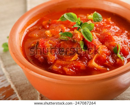delicious minestrone soup in a clay bowl. Selective focus - stock photo