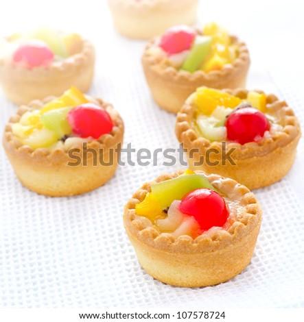 Delicious mini fruit tart with cherry orange kiwi - stock photo