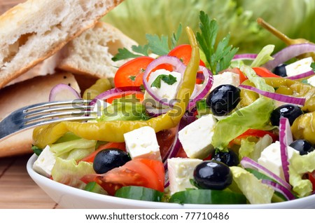 Delicious mixed Greek salad - stock photo