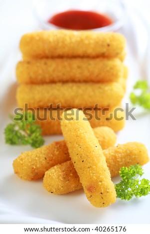 Delicious mozzarella fried sticks with tomato sauce - stock photo