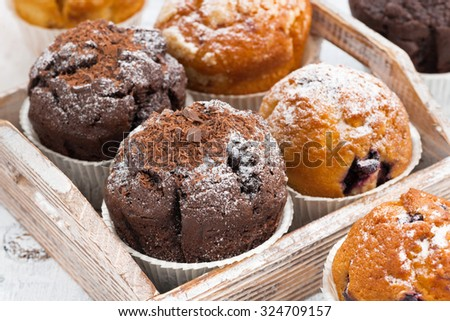 delicious muffins on a wooden tray, closeup