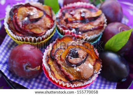delicious muffins with plums in rose shape and fresh fruits  - stock photo