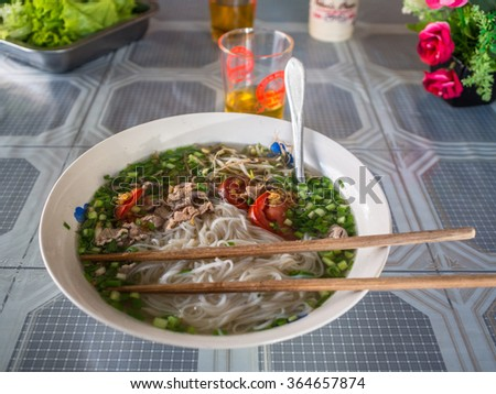 Delicious noodle soup in real local restaurant in Phonsavan in Laos - stock photo