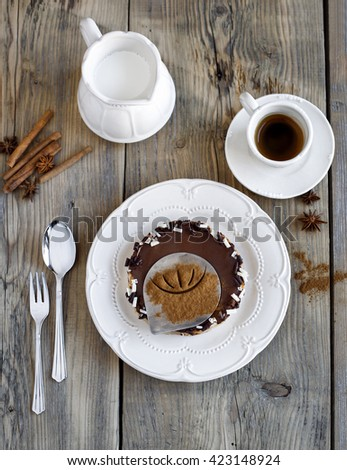Delicious  of banana cake Banoffee pie. Cakes and coffee white cup and milk, cinnamon sticks  and chocolate on old wooden table on  wooden background. tasty homemade cheesecake pie, classic recipe  - stock photo