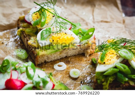 delicious open sandwich with avocado and egg