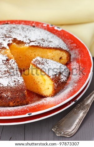 Delicious orange cake on a rustic plate.