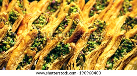 Delicious orient sweet - turkish pistachio baklava on the shelve of confectioners shop in Istanbul, Turkey - stock photo