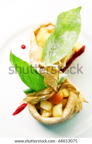 Delicious Pancake dessert with apple and strawberry sauce - stock photo