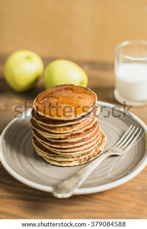 Delicious pancakes close up, with honey - stock photo