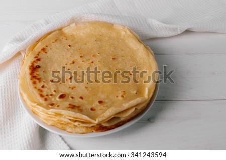delicious pancakes on a white wooden table - stock photo