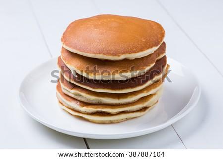 Delicious pancakes on white background - stock photo