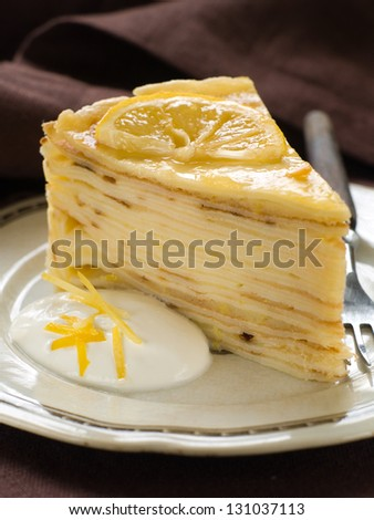 Delicious pancakes pie with lemon, selective focus