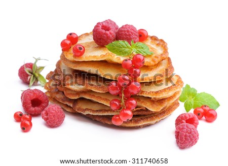 Delicious pancakes with berries - stock photo