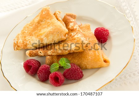 Delicious pancakes with berries and honey